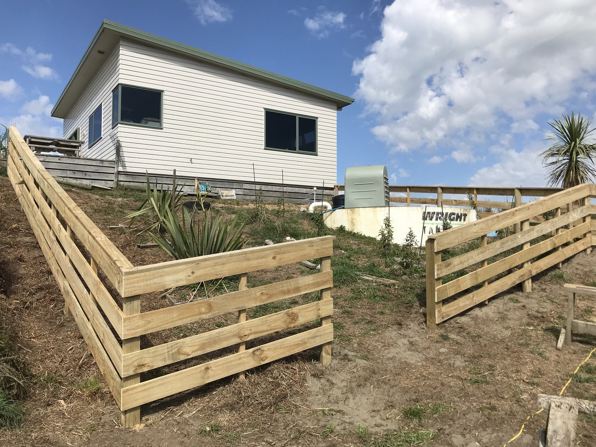 New fence around an area of the yard.
