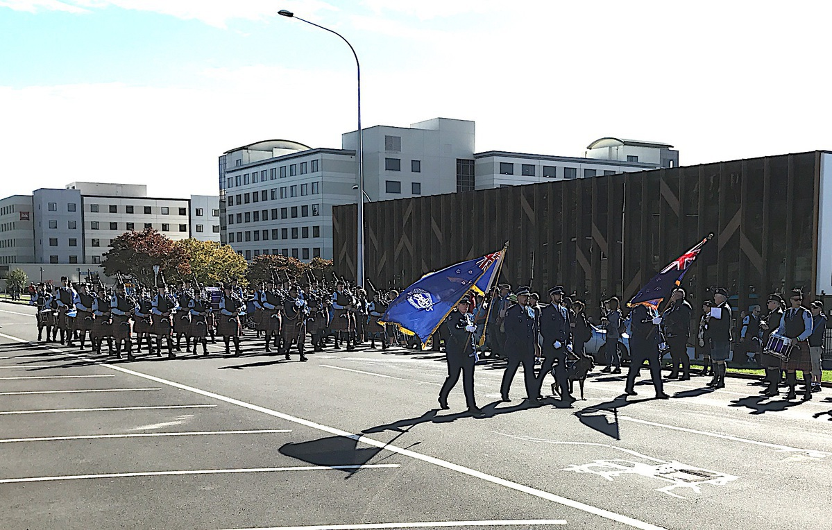 A pipe band marching down a street.