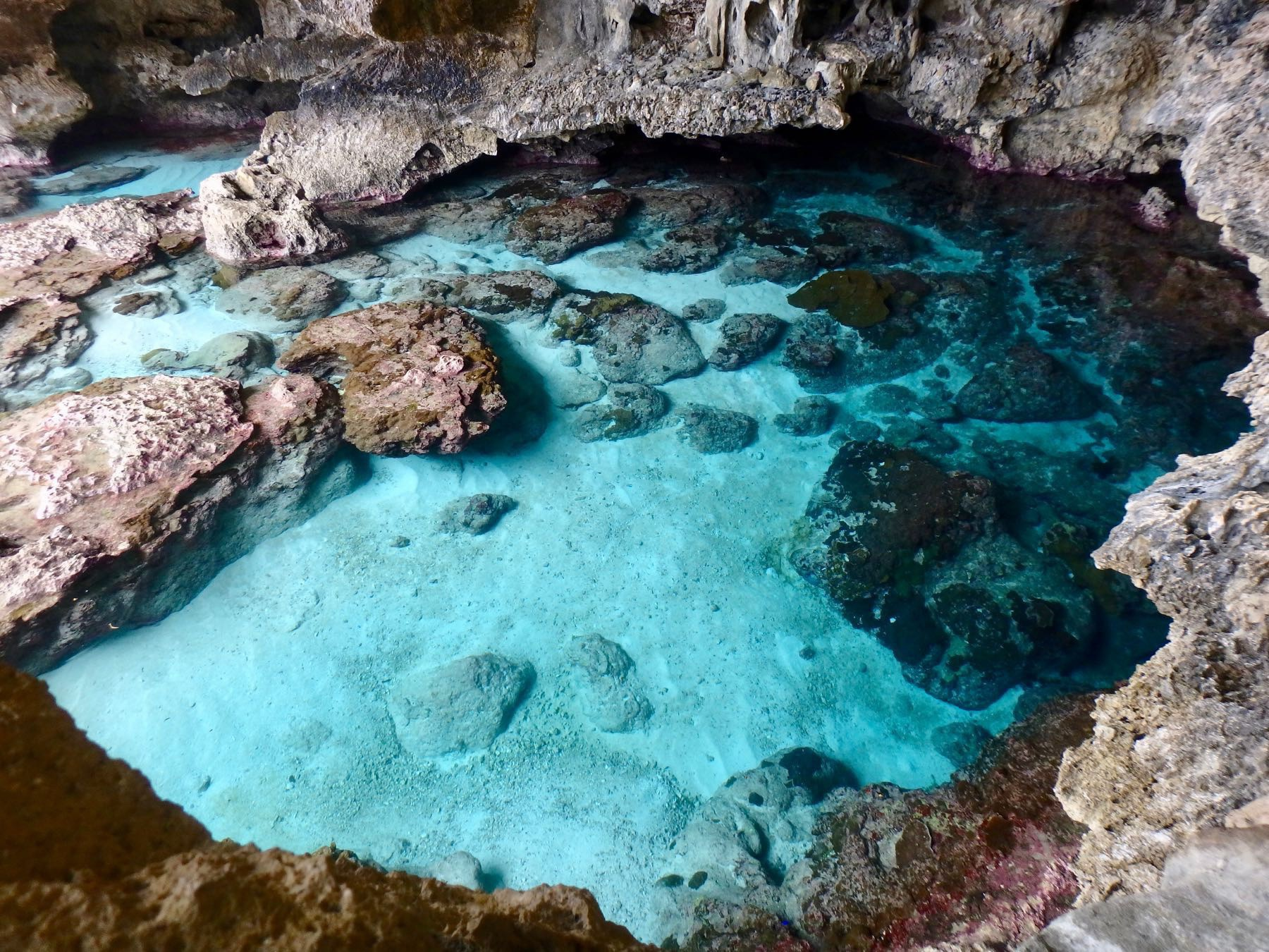 Blue water pool in a cave.