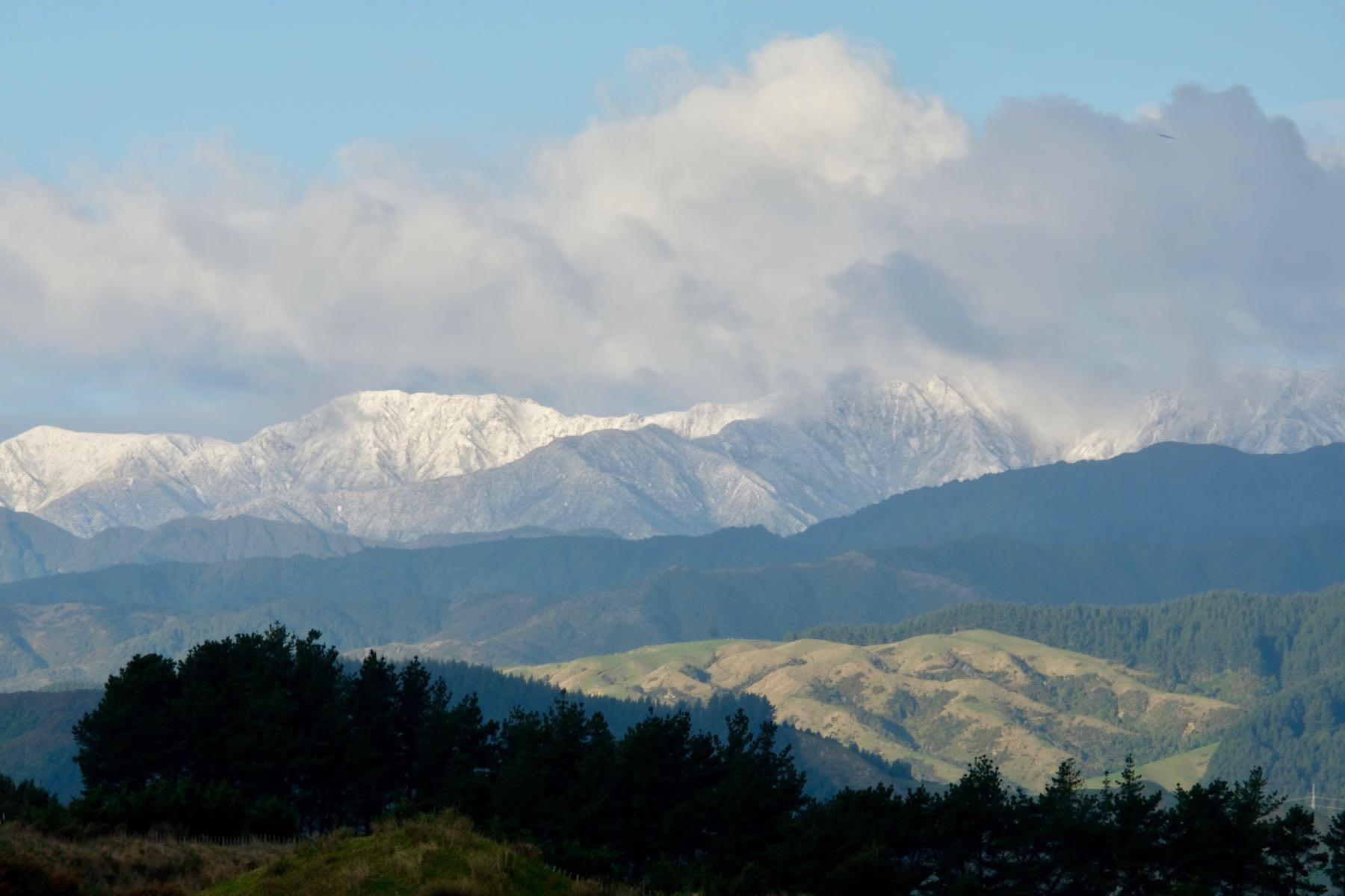 Mountain top with a light dusting of snow.