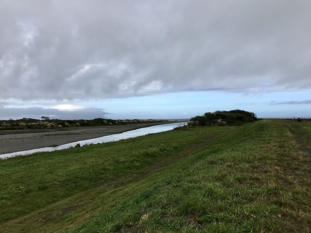 Looking west along the Ōtaki river with the sea in the distance.
