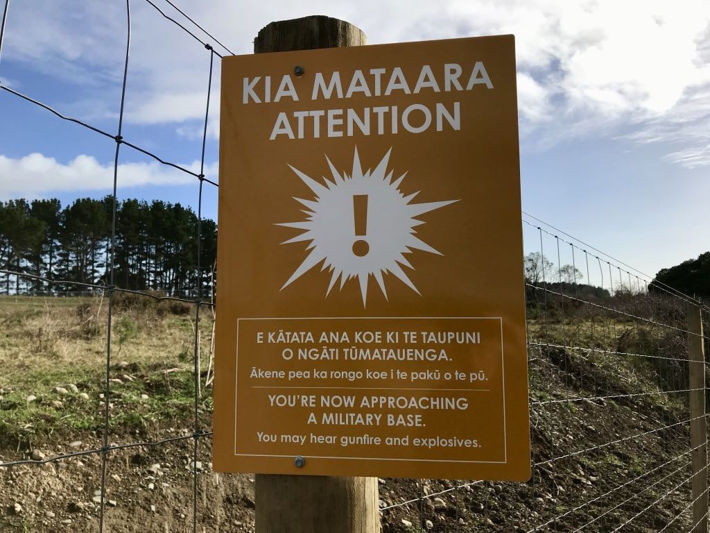 Sign in Māori and English: you may hear gunfire and exposives.