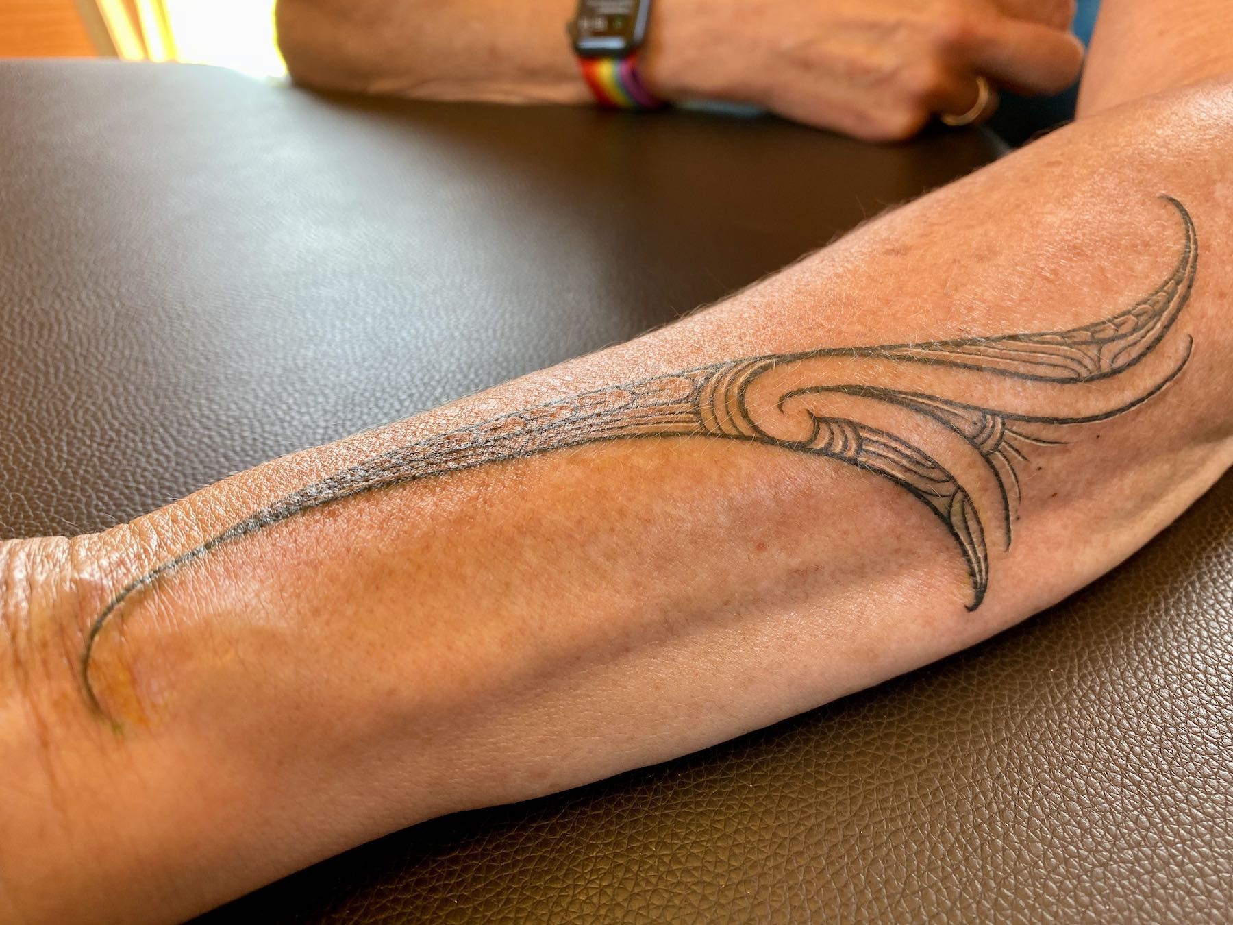A slender tattoo in black ink on my left forearm.