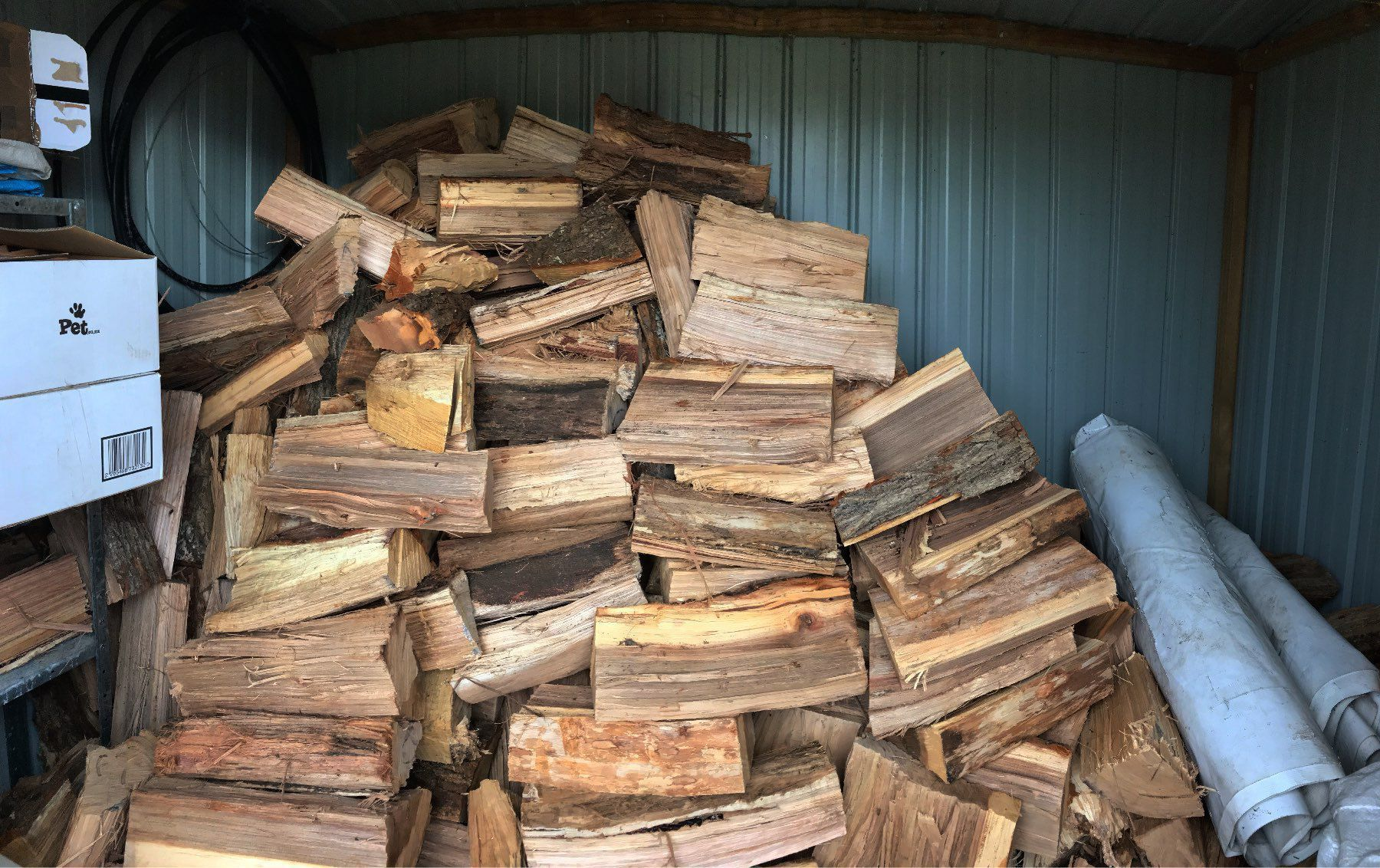 stacked firewood that coule easily tumble.