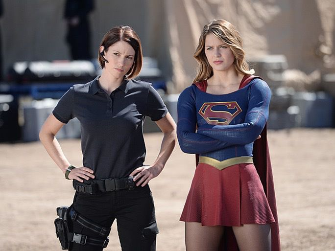 Agent Alex and Supergirl standing together.