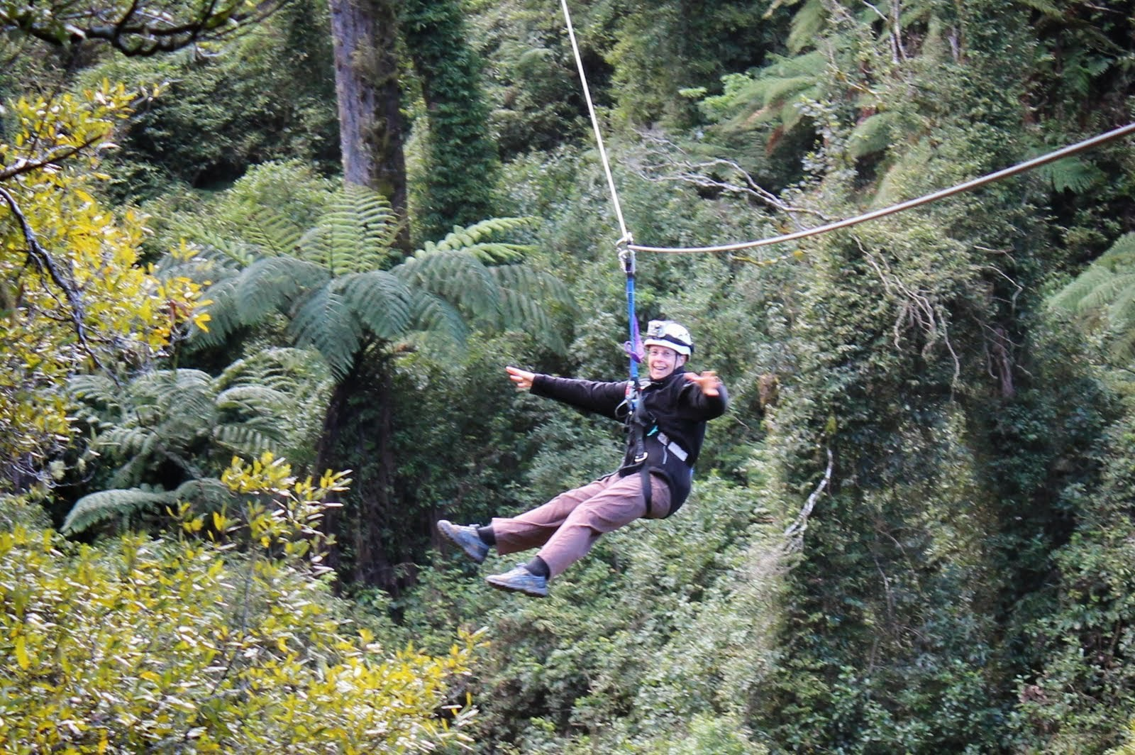Me dangling for a zipline after finally unclenching my hands from the rope.