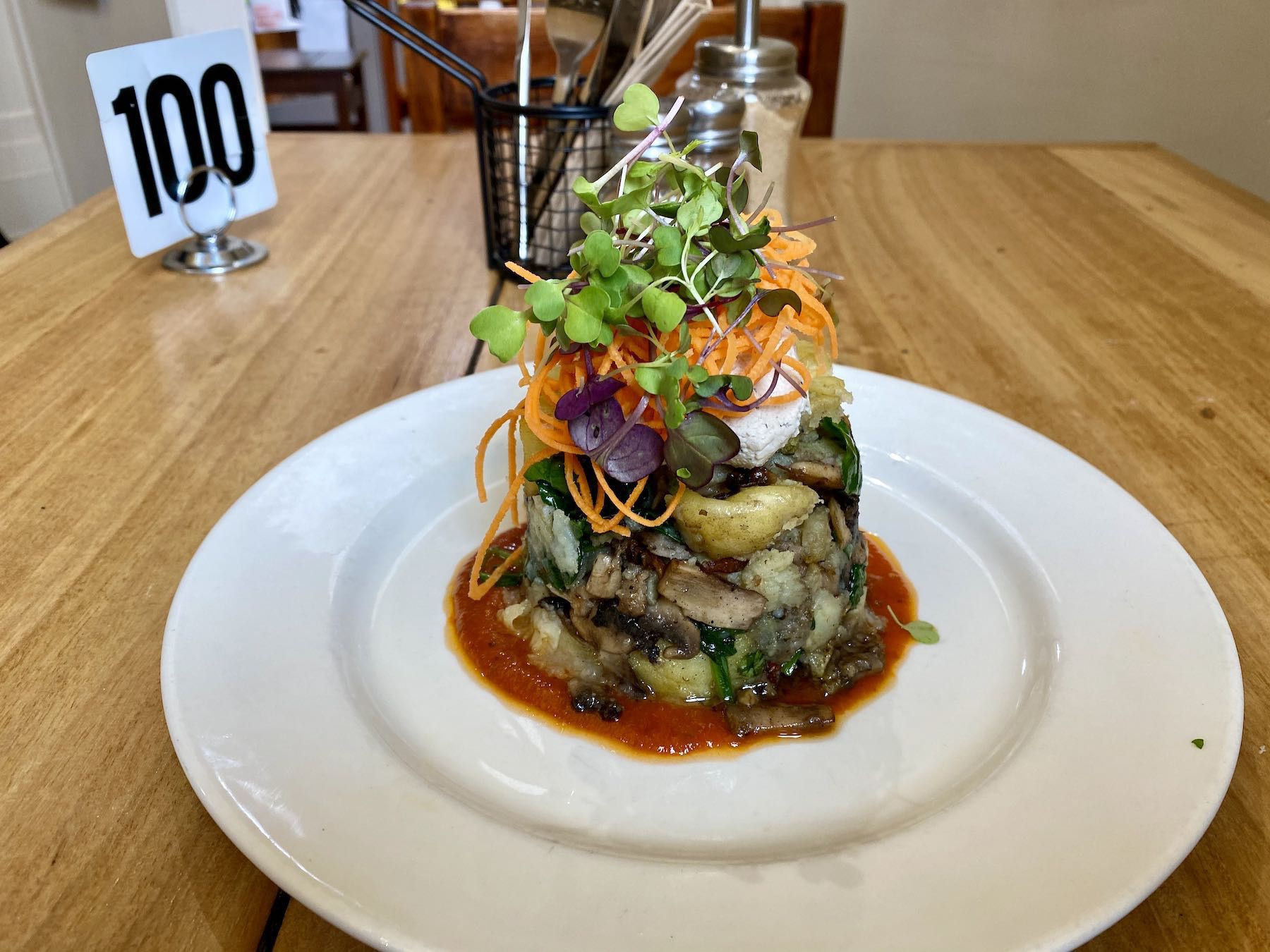 A toqwering stack of food — mushroom hash.