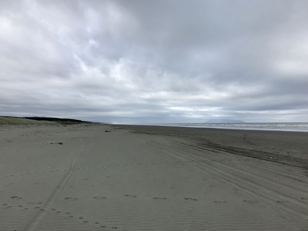 Looking south: empty beach as far as the eye can see.