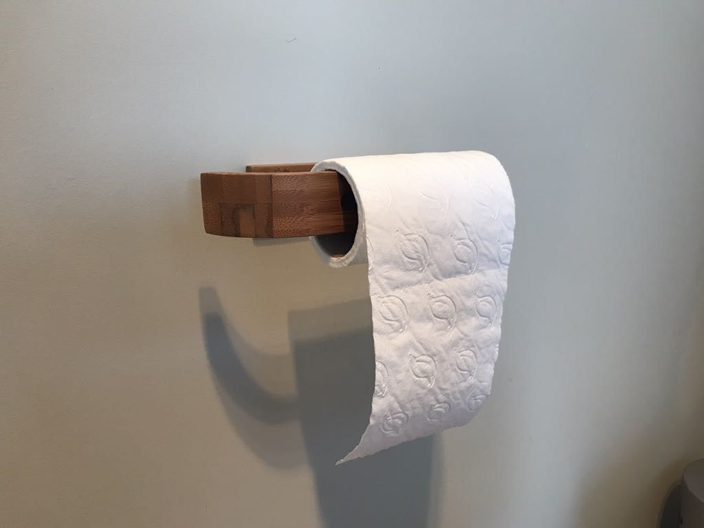 New bamboo toilet roll holder.