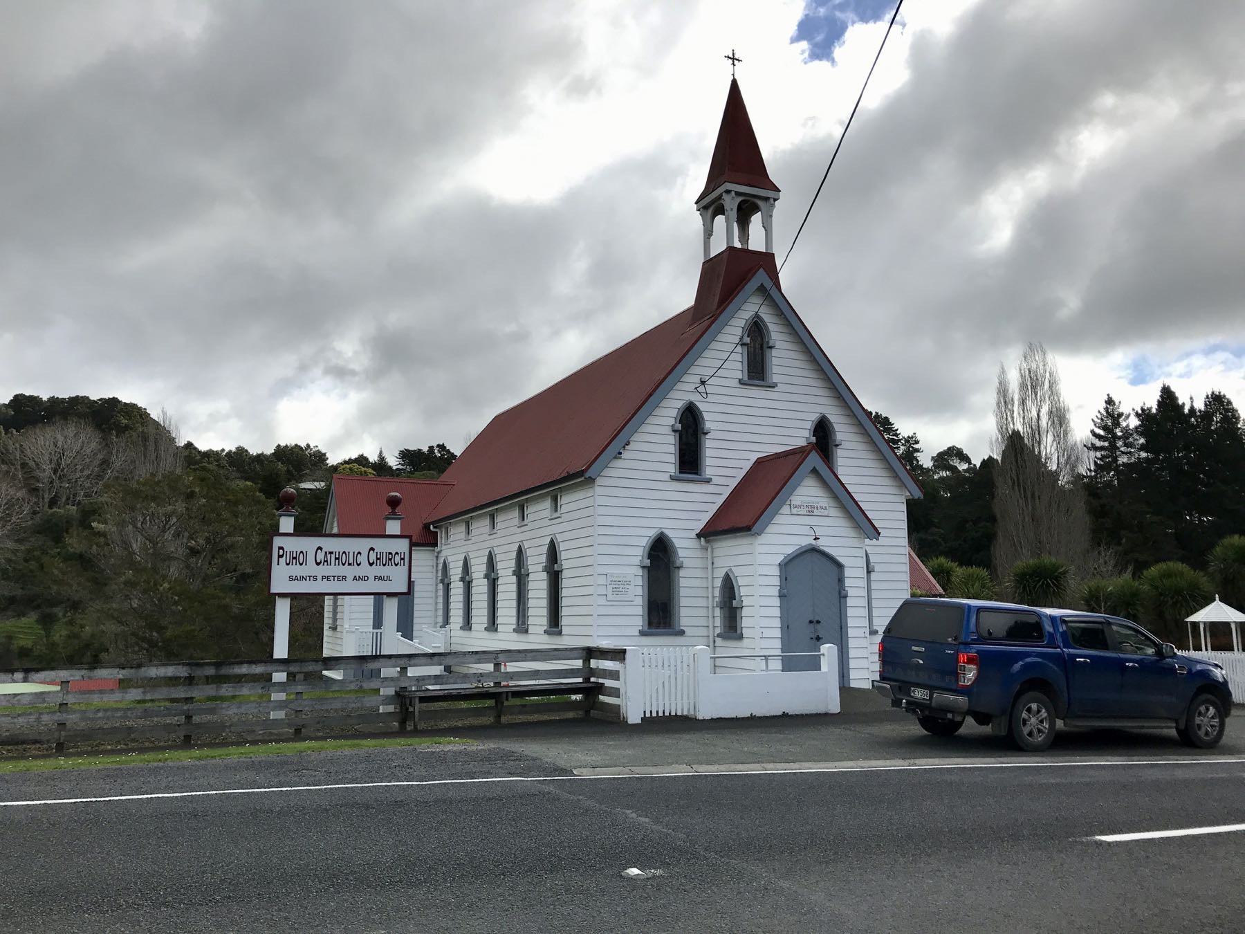 Puhoi church - a small wooden structure painted white, with a red roof.