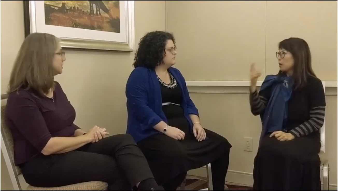 Interviewer (middle), sign translater (left) and deaf interviewee (right).