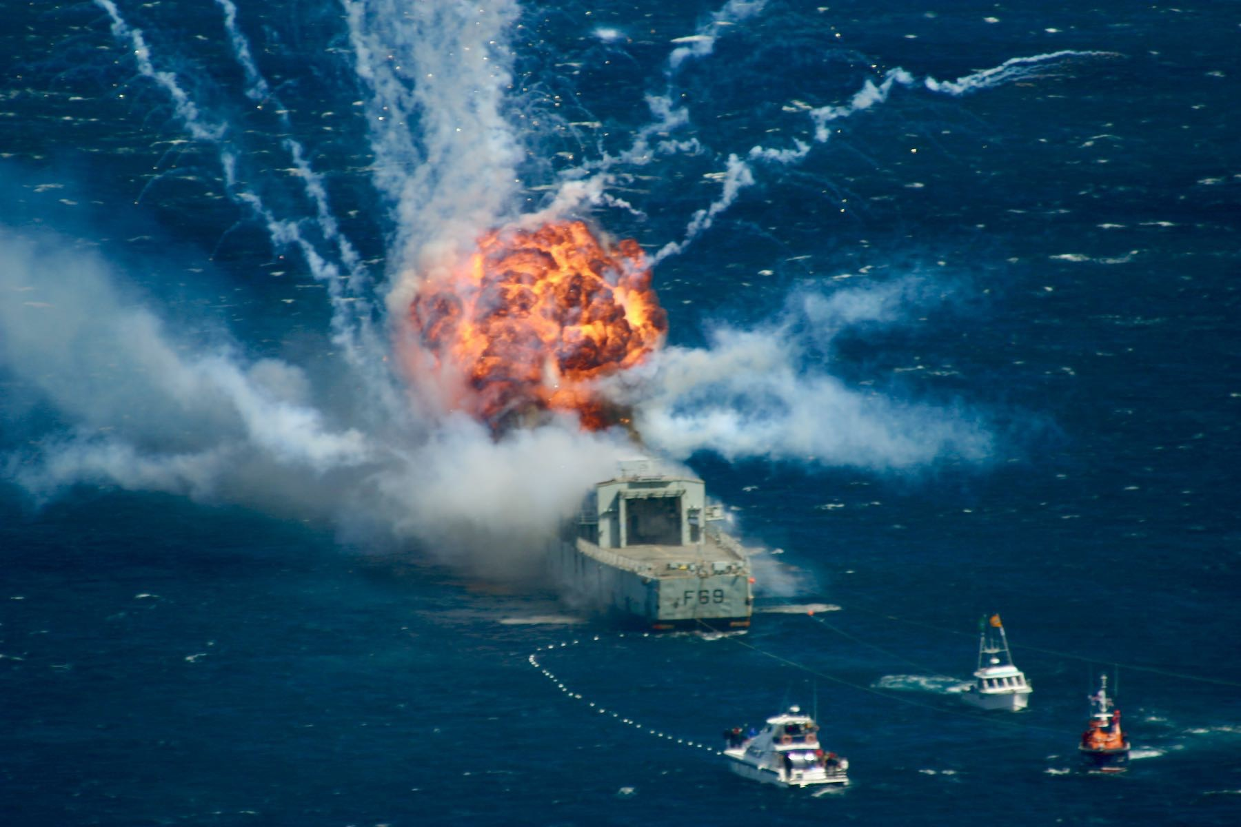 A huge fireball at the rear of Navy frigate Wellington.