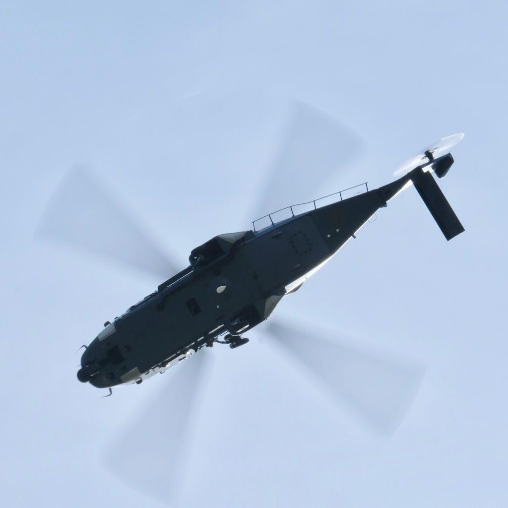 NH90 helicopter directly overhead.