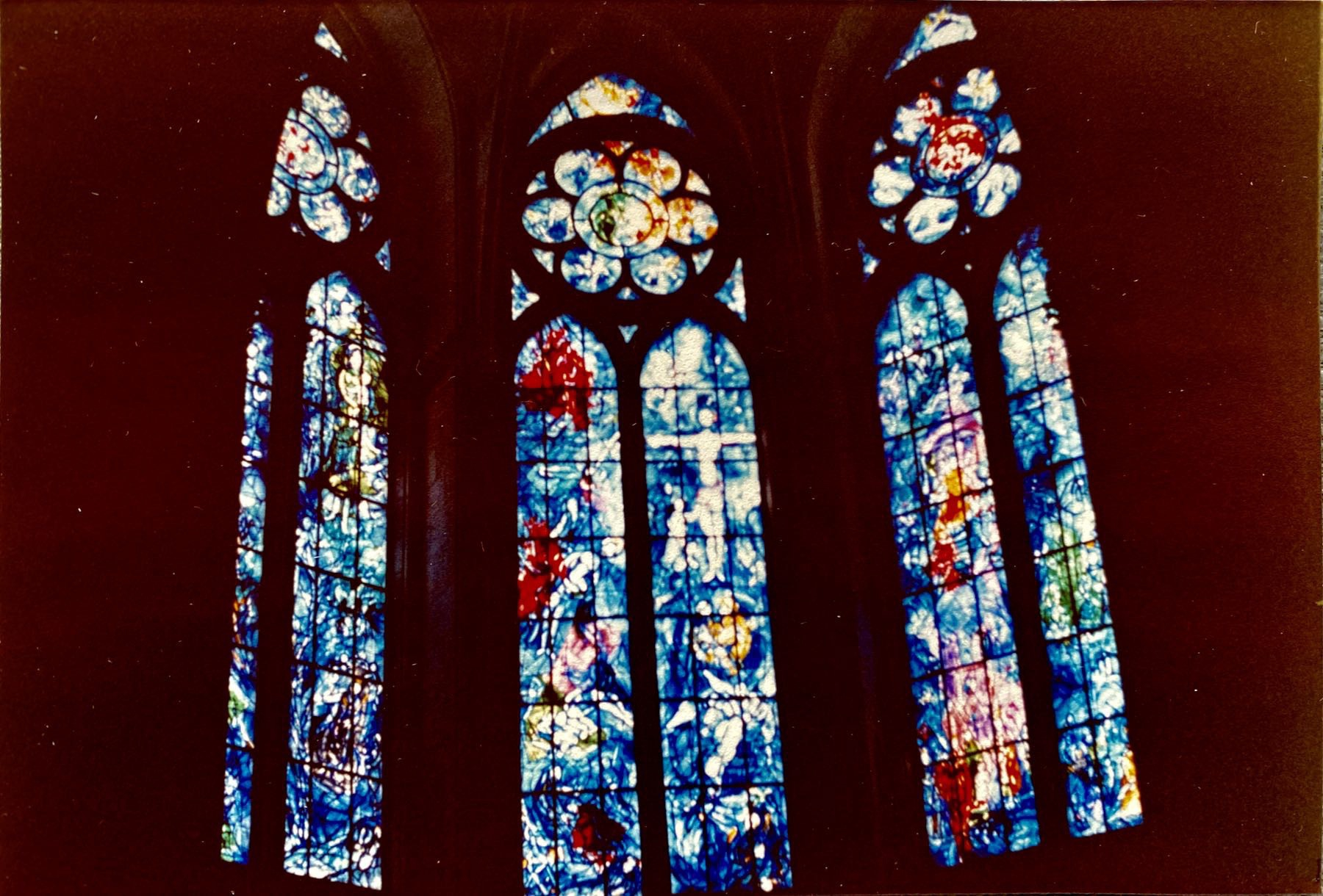 Cathedral windows in stained glass with a predominant blue colour.