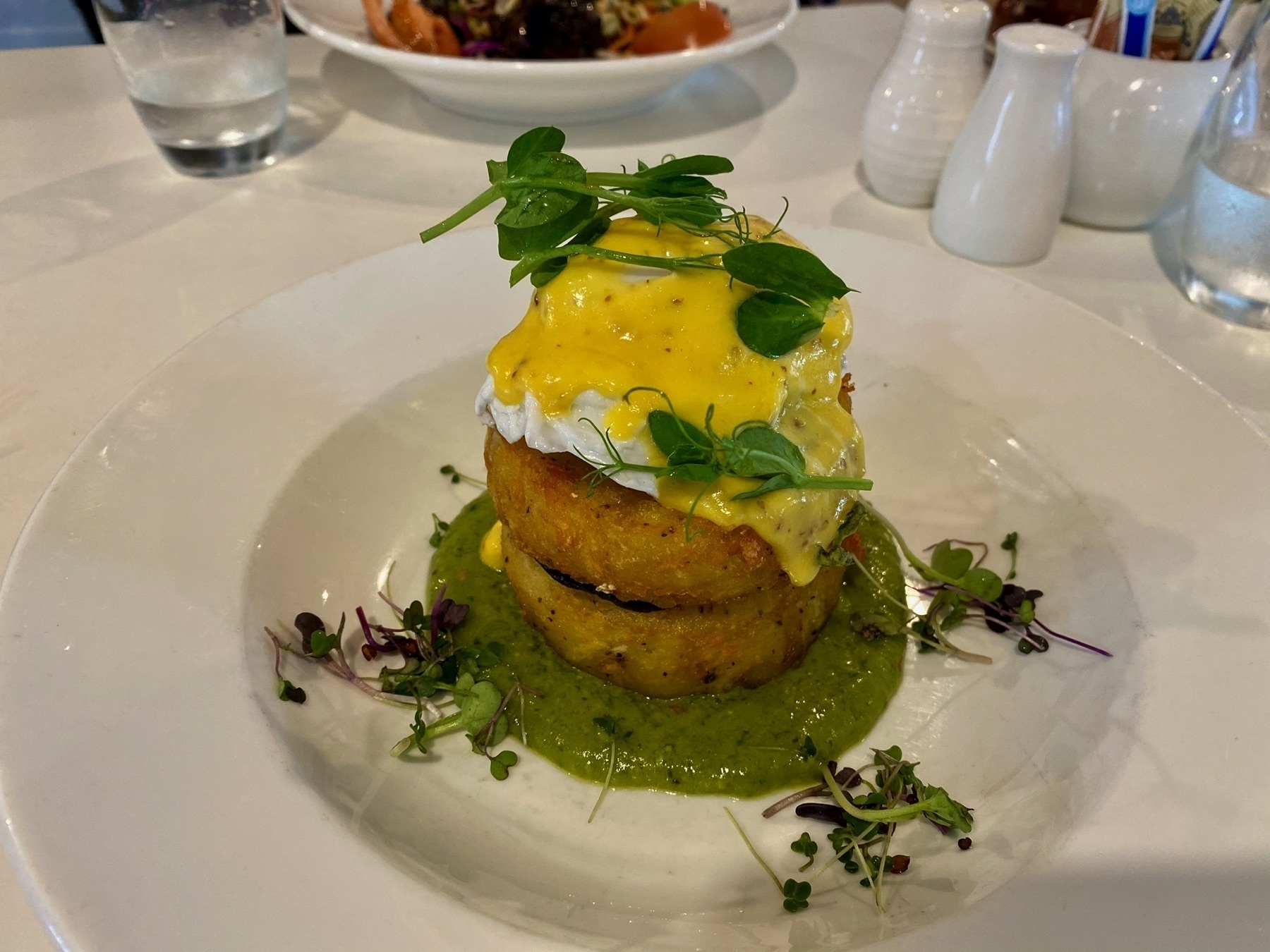 Potato rosti stack with avocado, egg, portobello mushrooms.