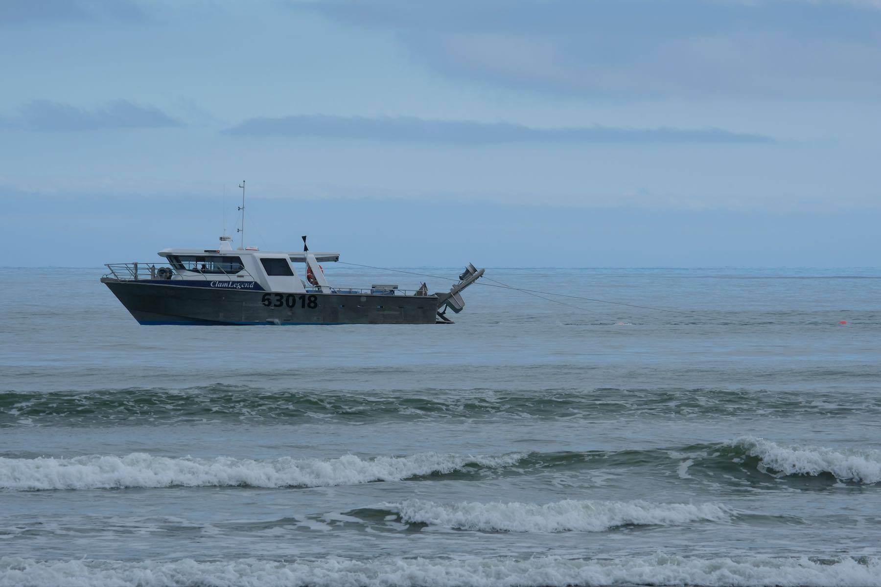 Fishing vessel 63018 working very close to shore again.