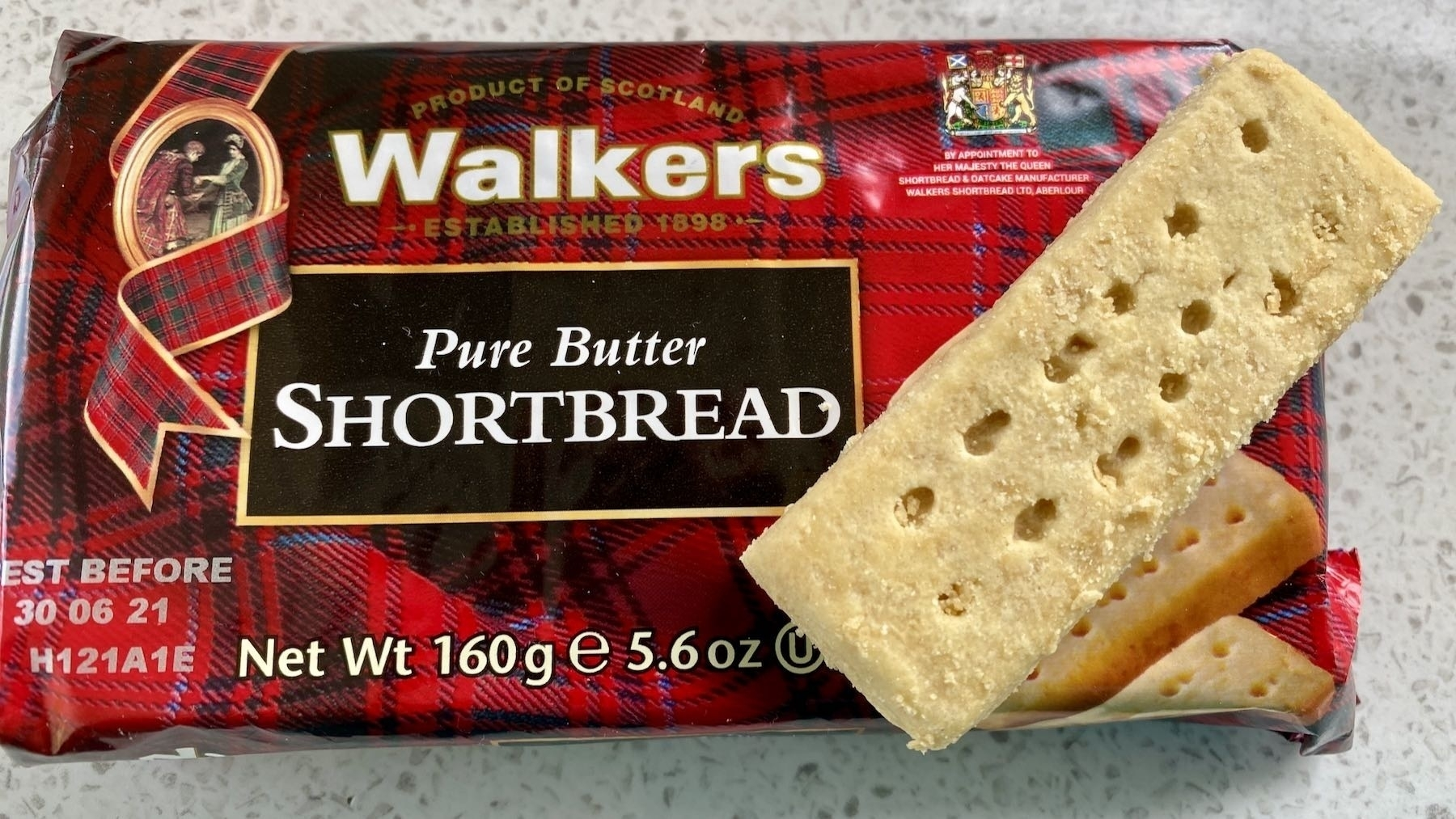 Shortbread packet with one biscuit on top.