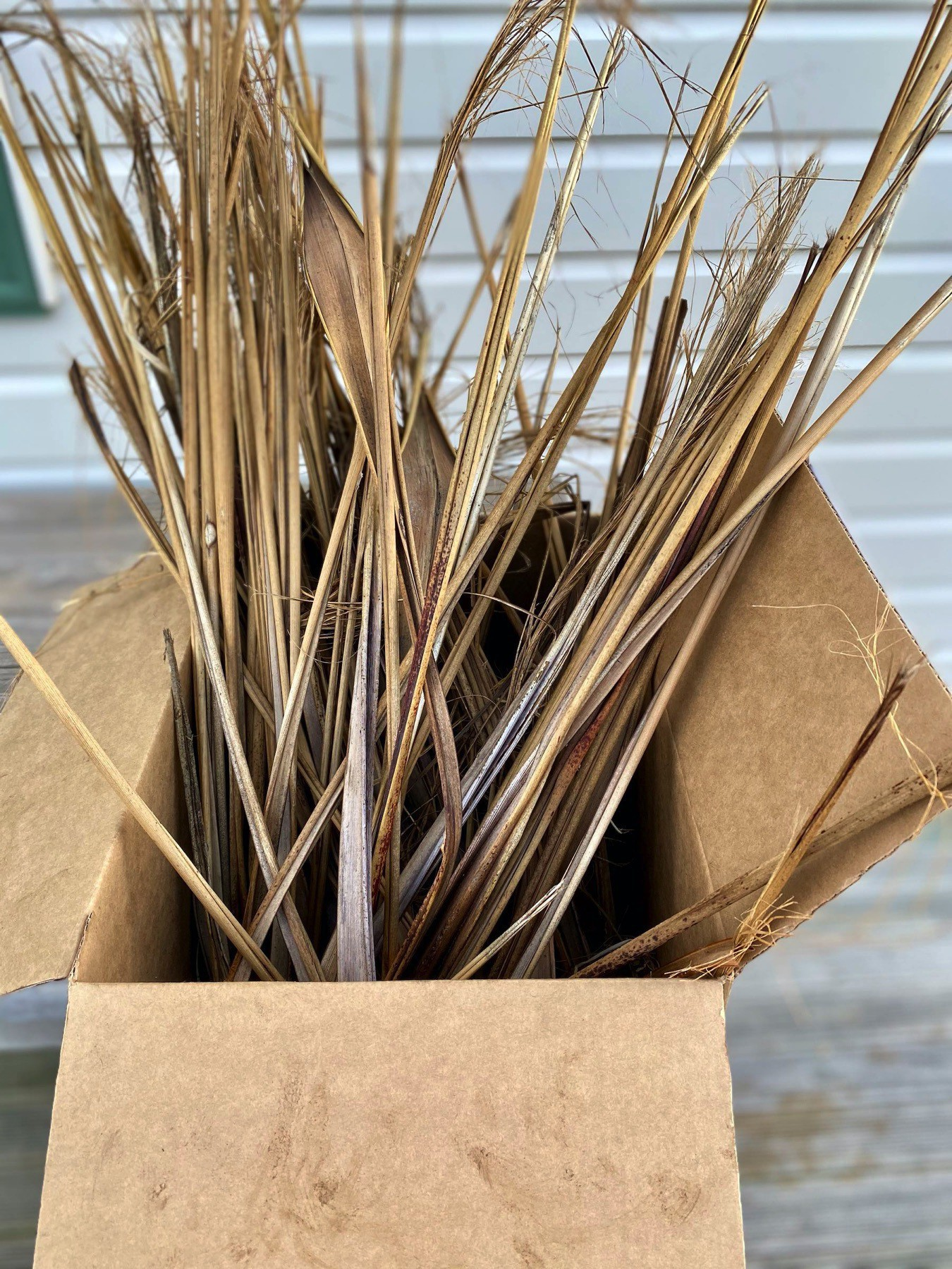 A box of dry flax leaves.