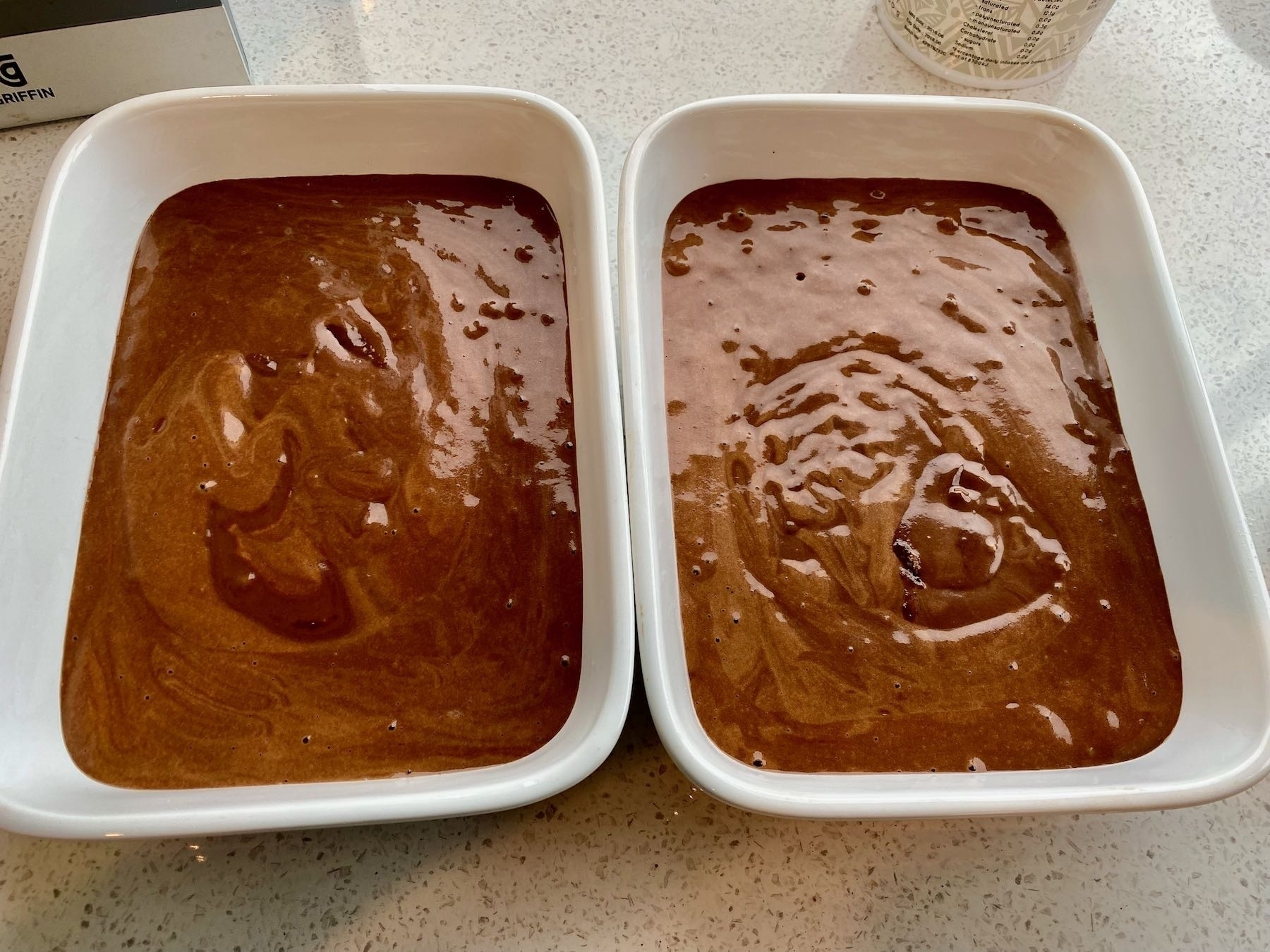 Uncooked cake in baking pans.
