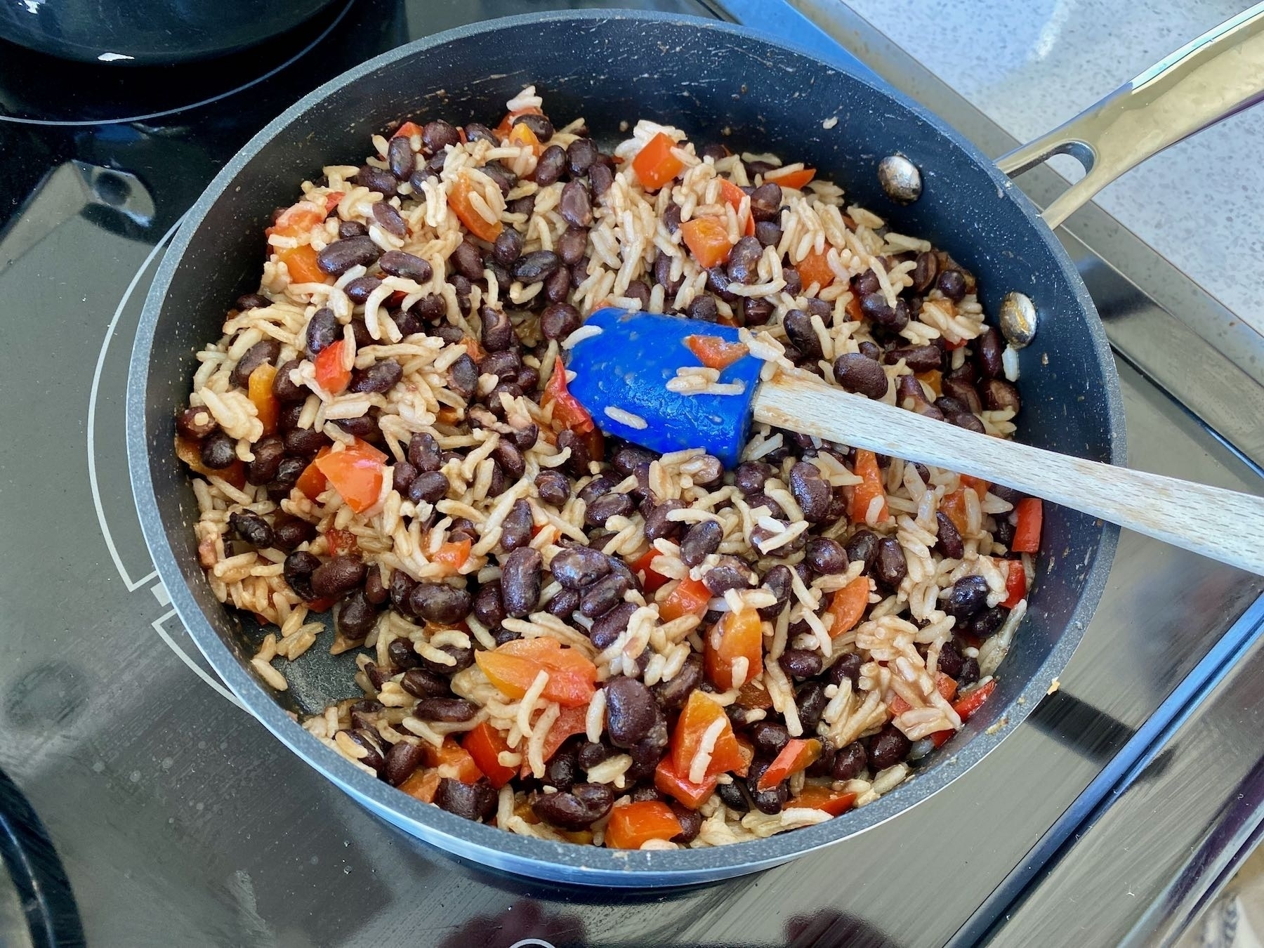 Beans and rice cooking in a frypan.