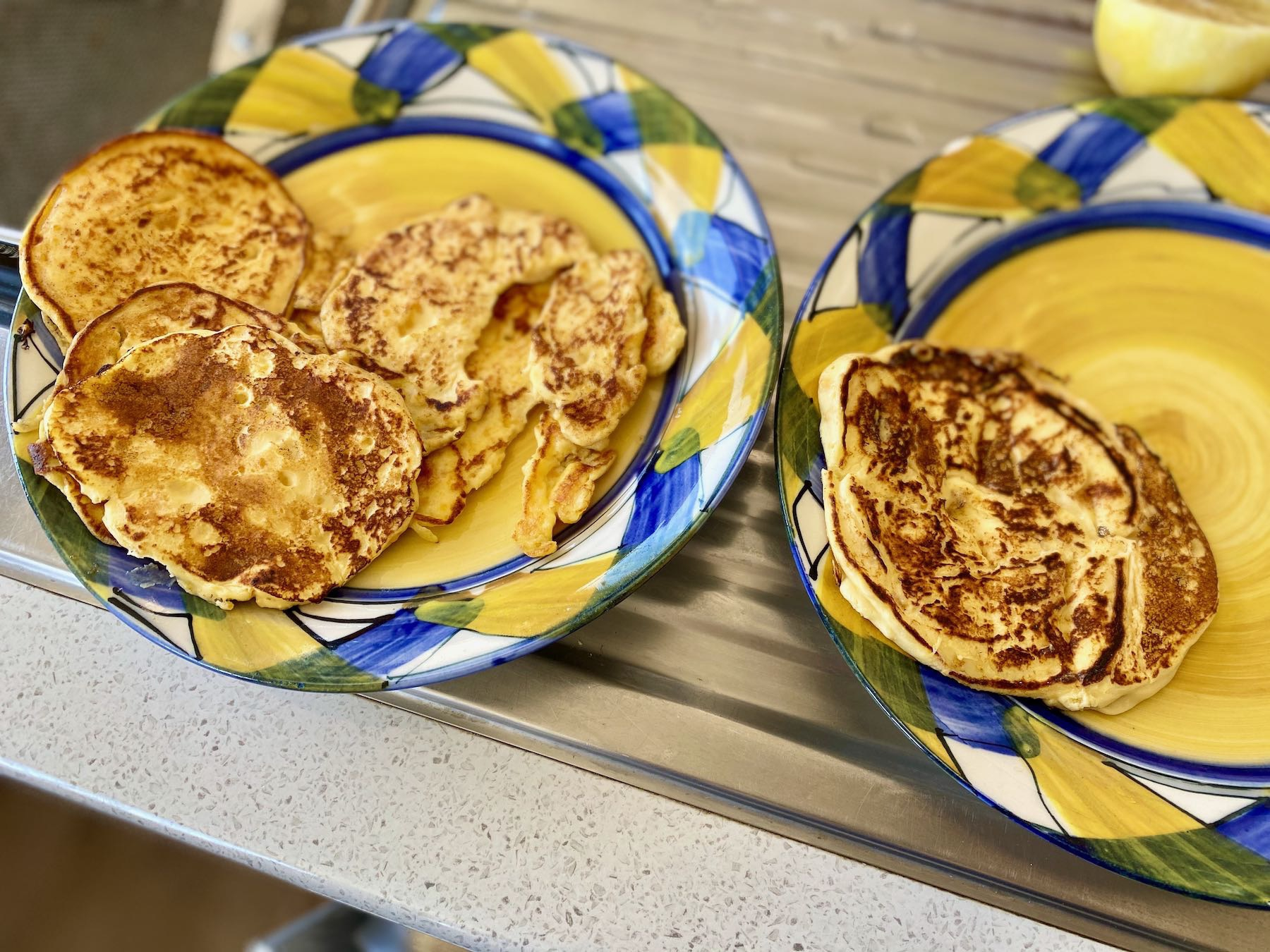 Two plates with pancakes.