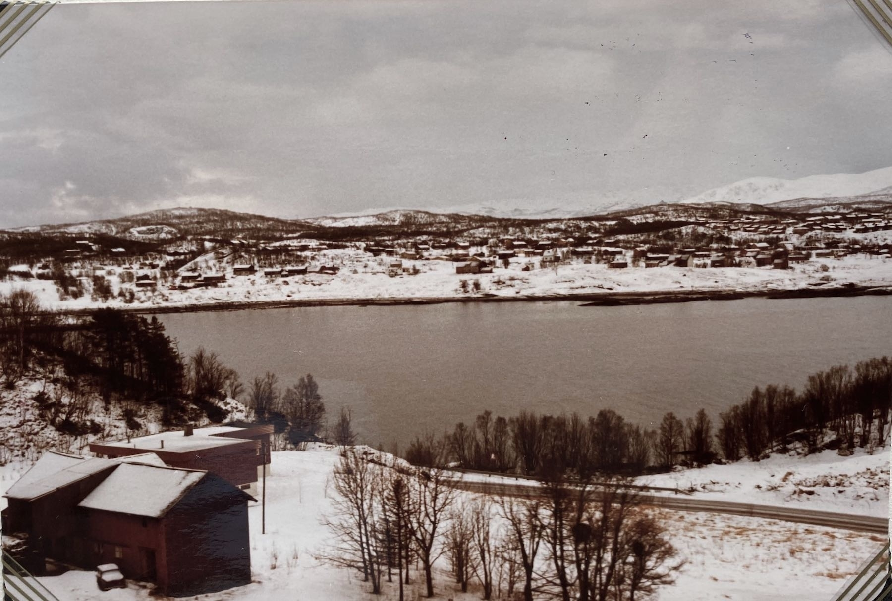 Snowy landscape and a fjord.