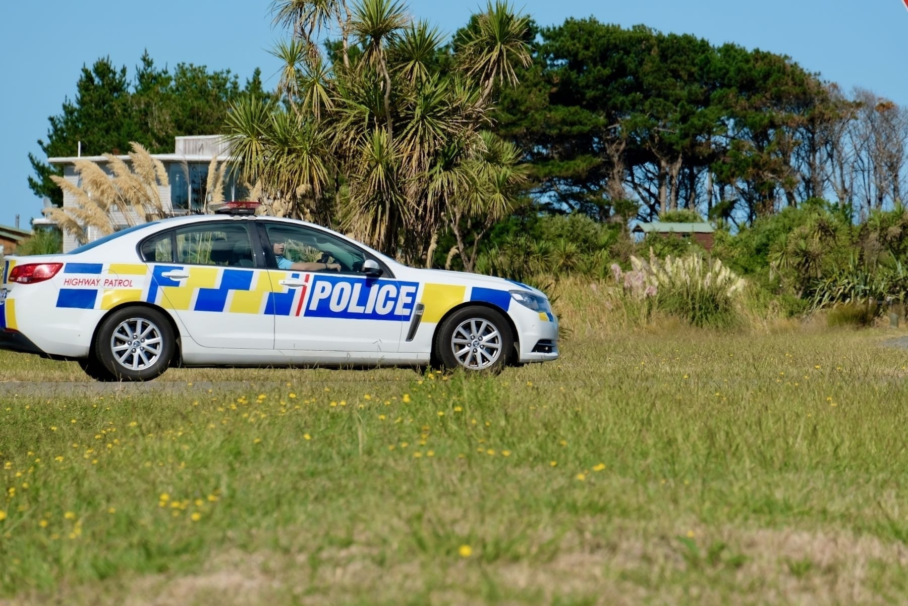 Police car on a local road.