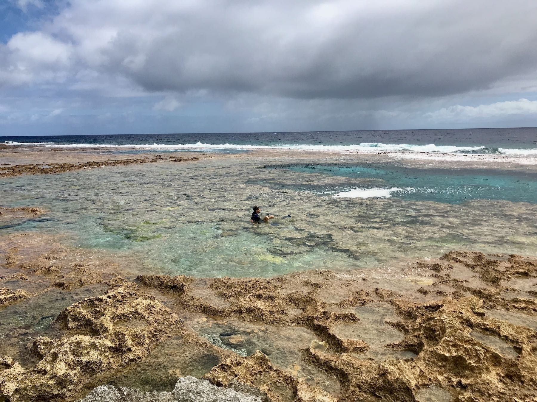A person in the water on the reef.
