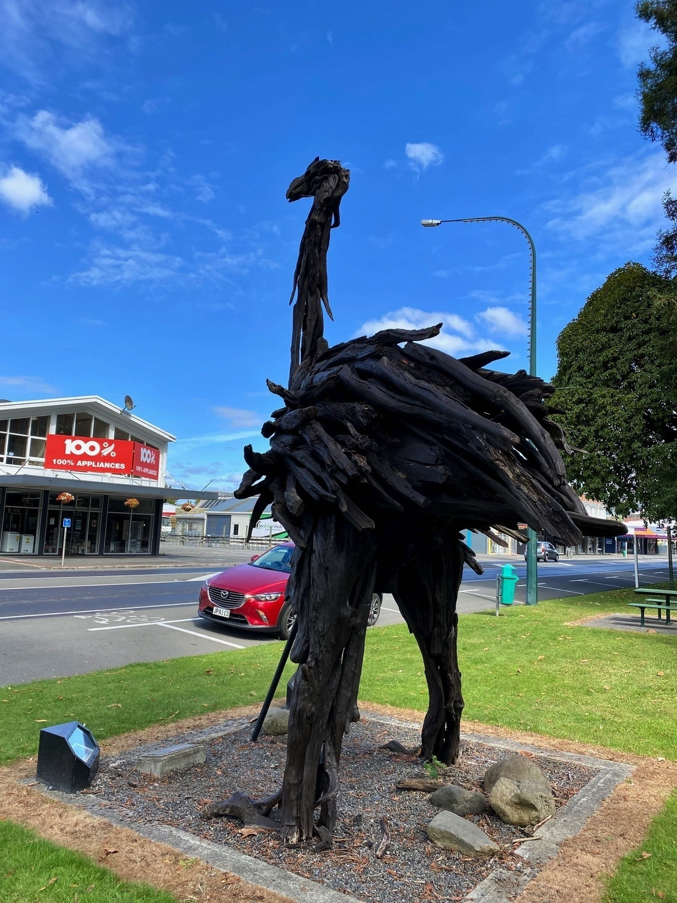 Lifesize moa sculpture, 2 or 3 metres tall, from another angle.