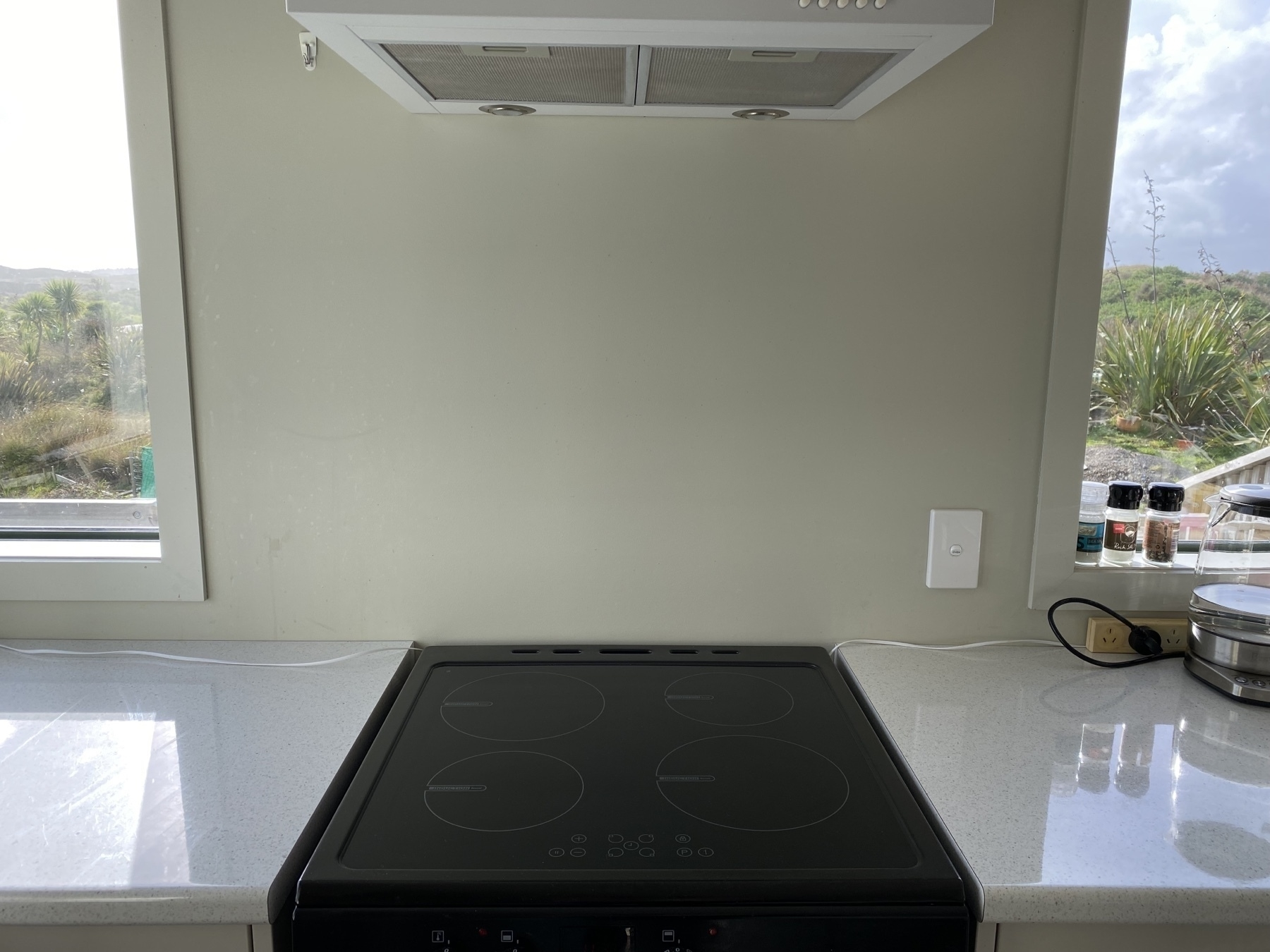 Blank wall behind oven.